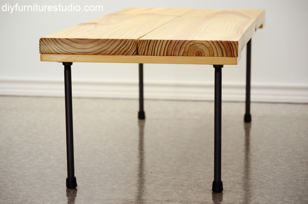 another closeup of end grain of DIY rustic modern coffee table or bench with plumbing pipe legs
