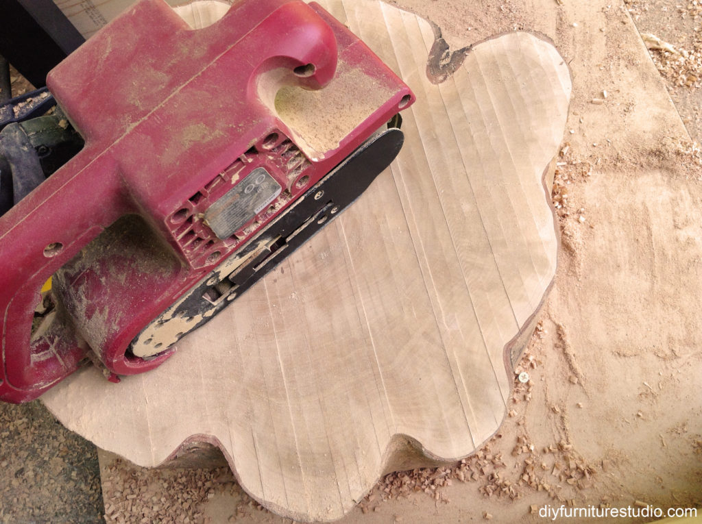 sanding tree stump slice with belt sander from harbor freight