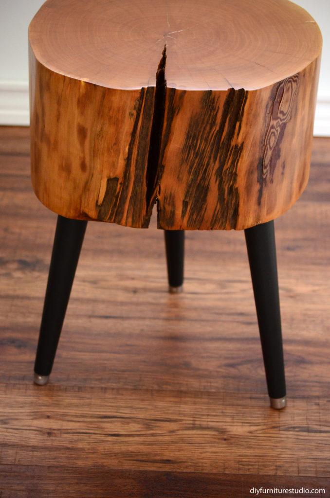 stump table with black mid century modern legs