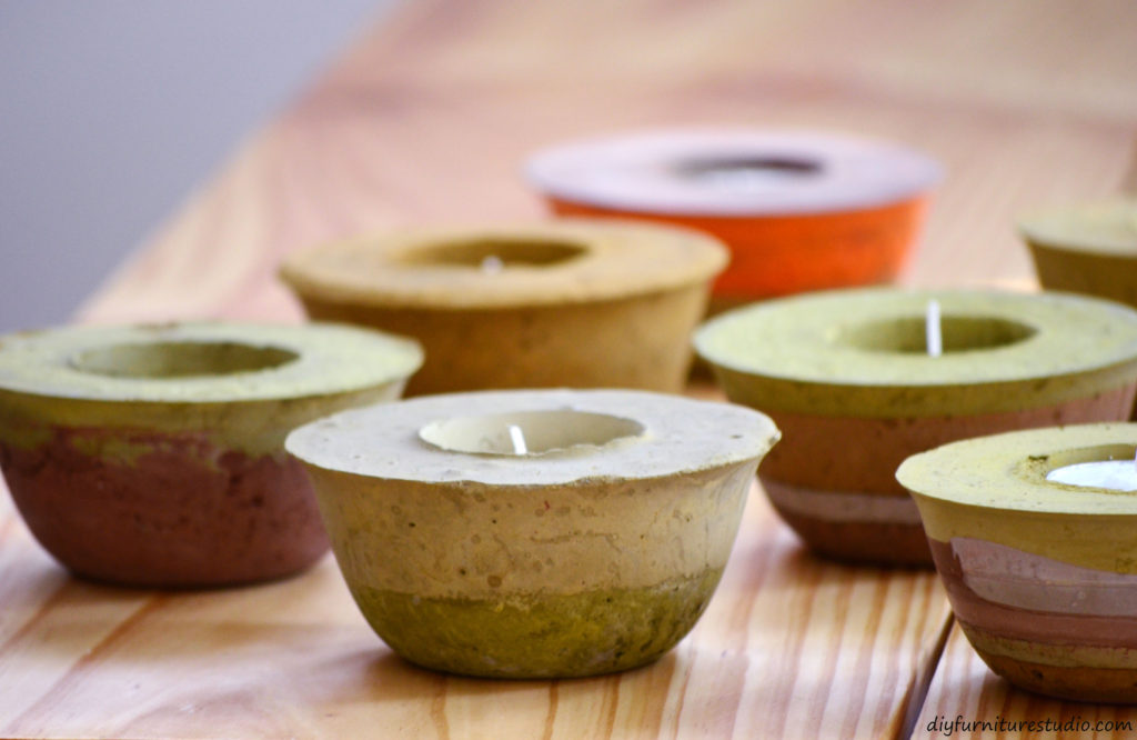 DIY cement candle holders tinted with latex paint. See diyfurniturestudio.com for tutorial.