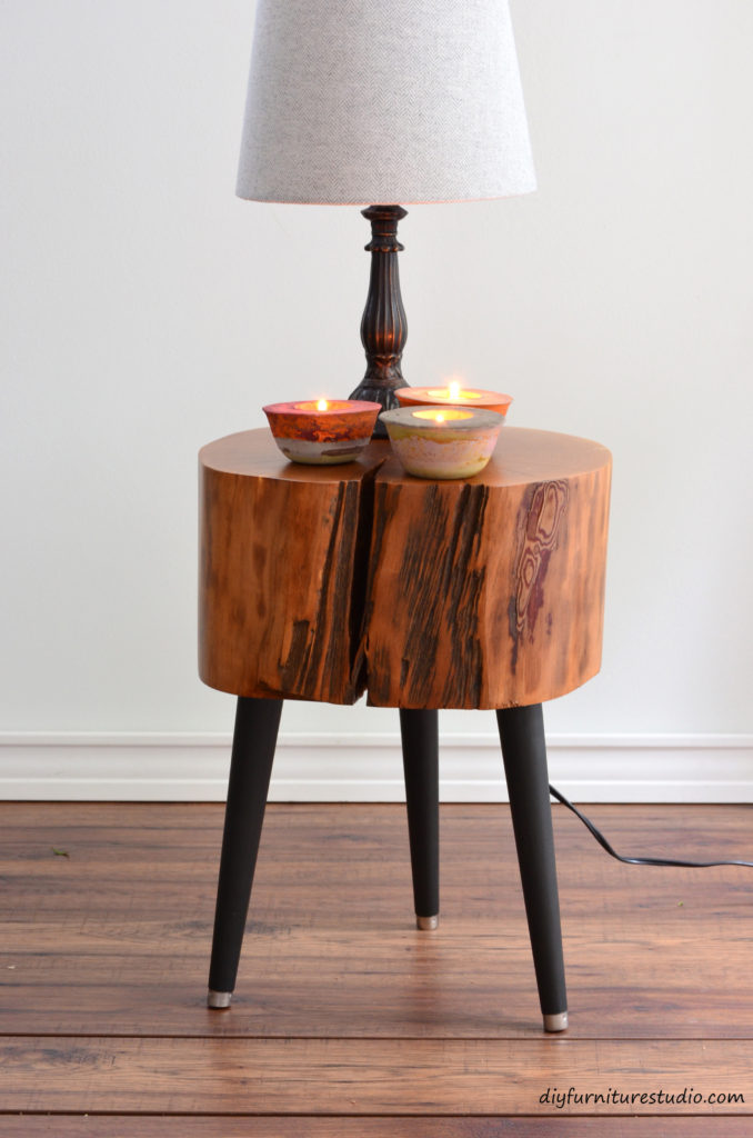 Live edge side table with DIY mid-century modern legs and DIY colorful cement tealight holders decor.