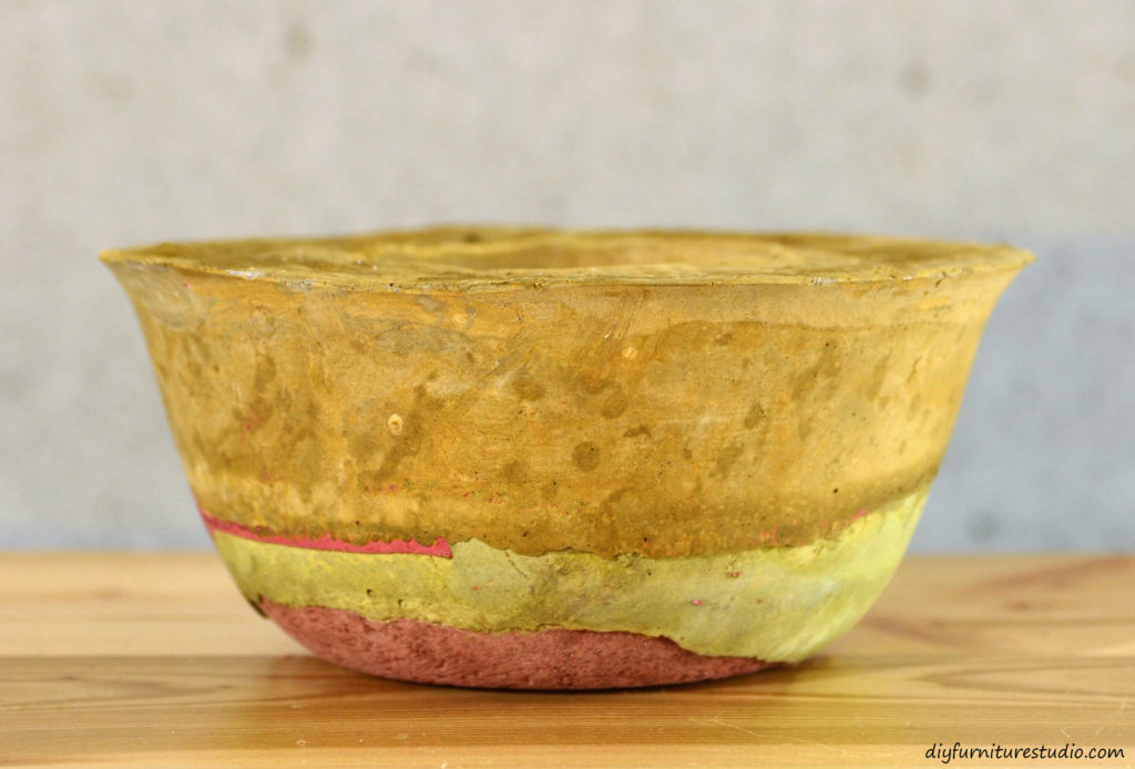 Colorful DIY cement candle holder tinted with latex paint. See diyfurniturestudio.com for tutorial.