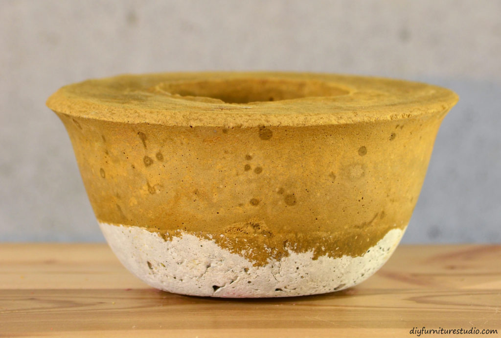 Ochre DIY cement candle holder tinted with latex paint. See diyfurniturestudio.com for tutorial.