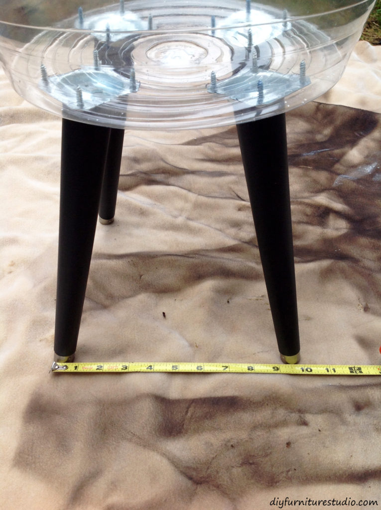 DIY cement side table. Position the legs equal distance apart before adding cement to the mold.