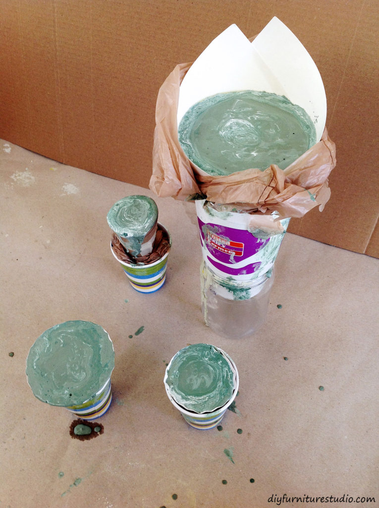 DIY modern cement Christmas trees made green with latex paint added to the mix.