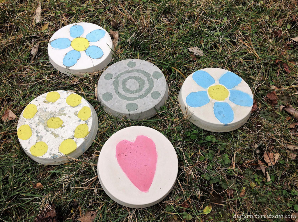 DIY Cement Stepping Stones with Inlaid Colored Cement Designs.